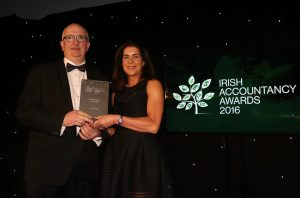Pat Sutton receives award from Anne Keogh